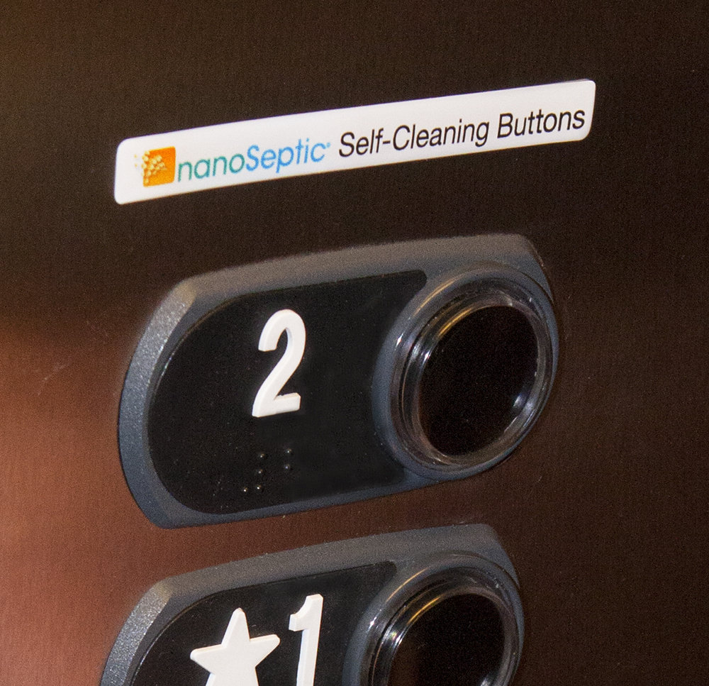NanoSeptic self-cleaning button covers for elevators